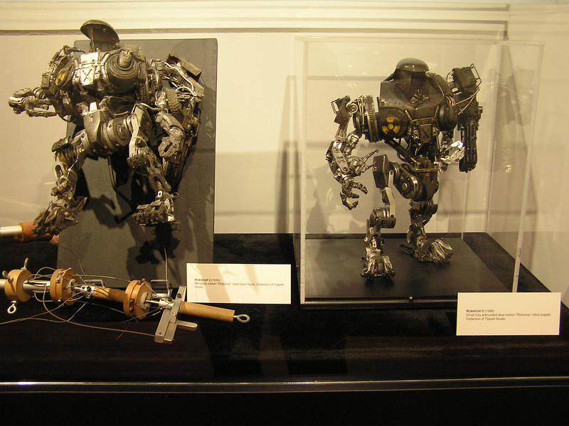Rubber robot stunt figure (left) and fully articulated stop-motion robot for <i>Robocop 2</i> (1990)