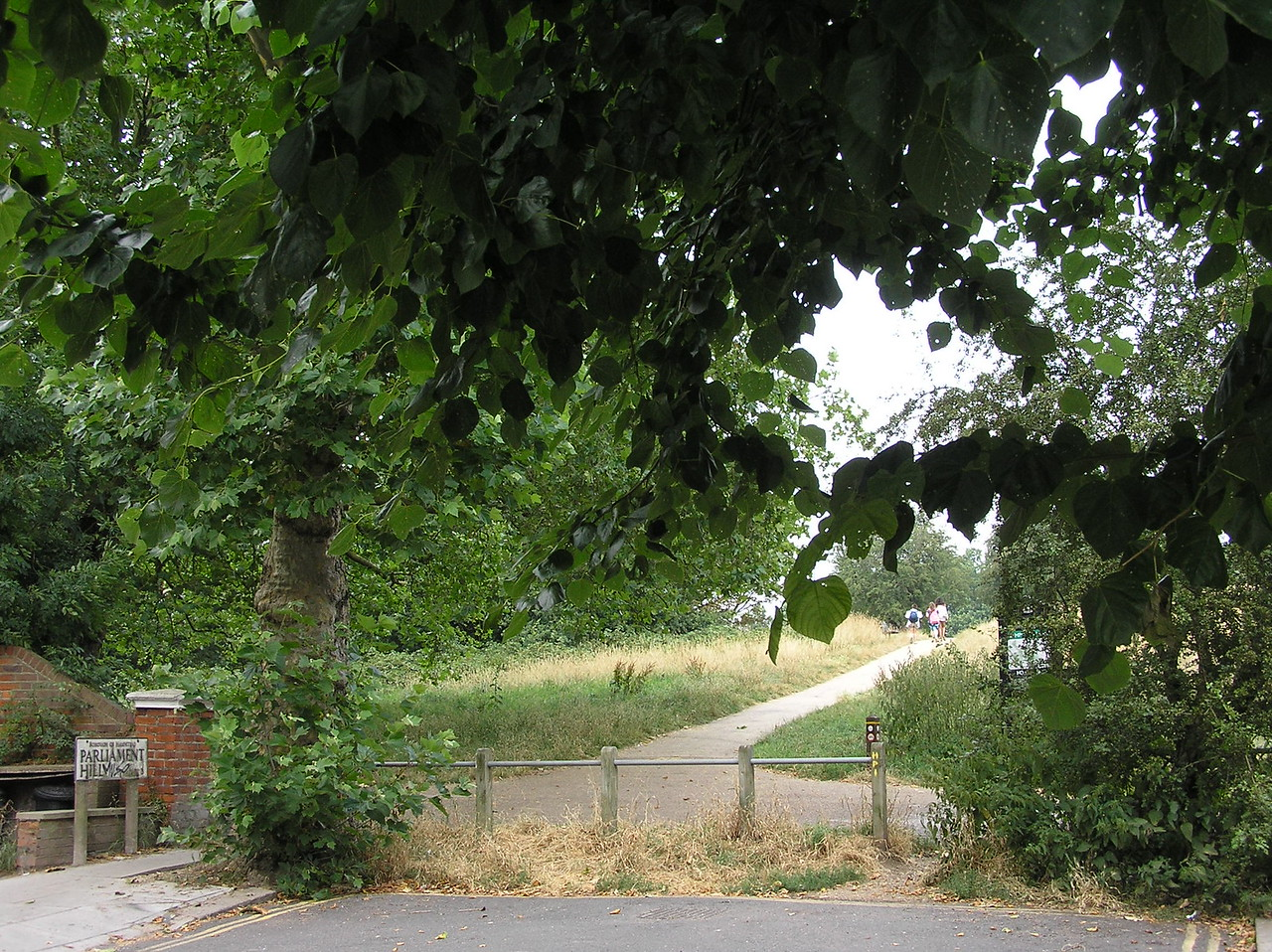 It may be too small to see, but the sign on the left marks the beginning of the Parliament Hill trail. Parliament Hill is one of the highest points in London and is where one can find the Sahlin/Henson bench.