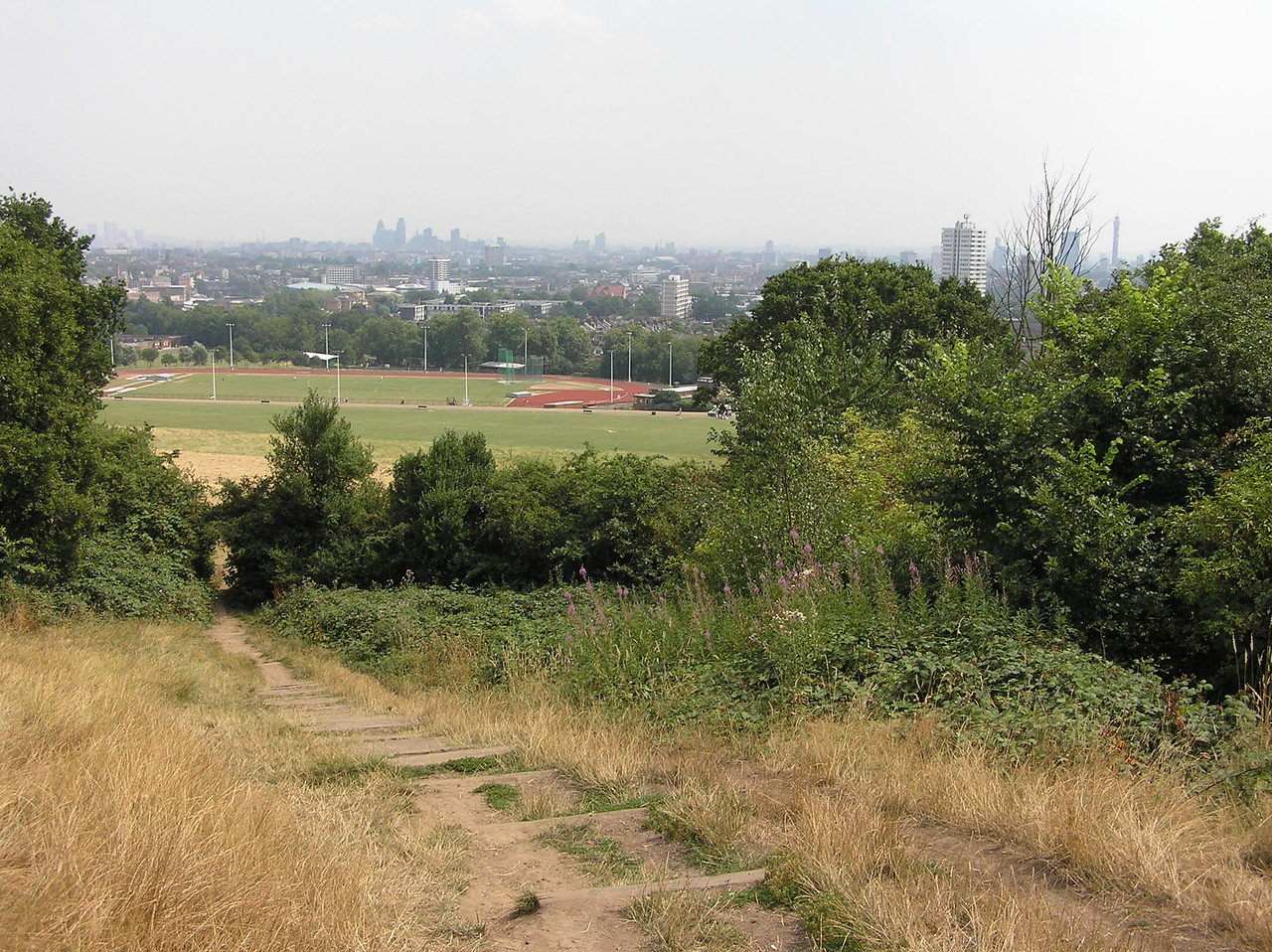 As I walk down Parliament Hill I begin to see the athletics fields at the southern end of Hampstead Heath. You can see London a little better in this photo.