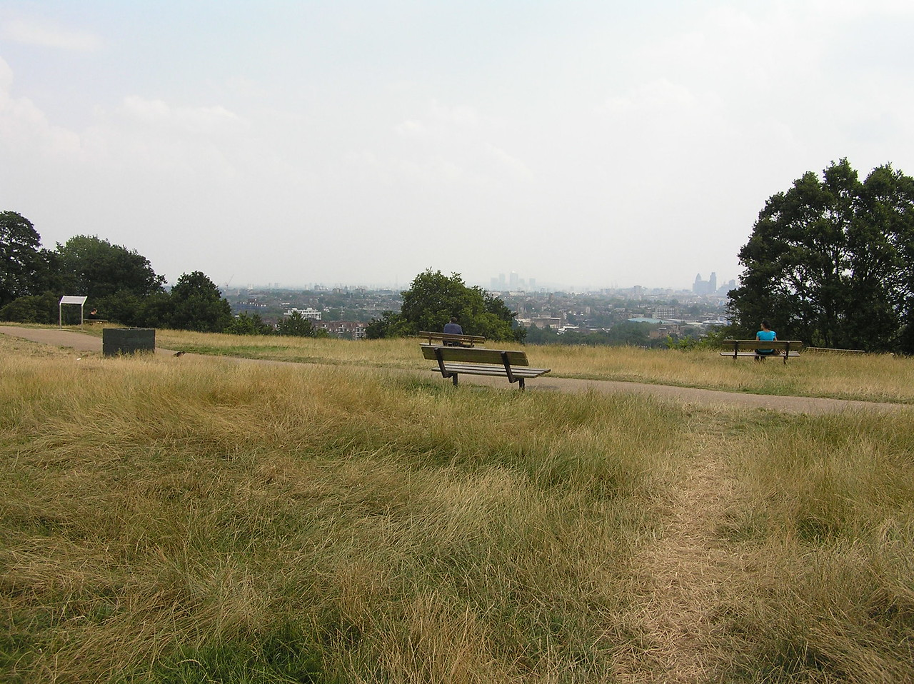 The were several benches at the top of Parliament Hill, each with a dedication engraved upon it. As one of the highest points in London, it offers a nice view of the city below.