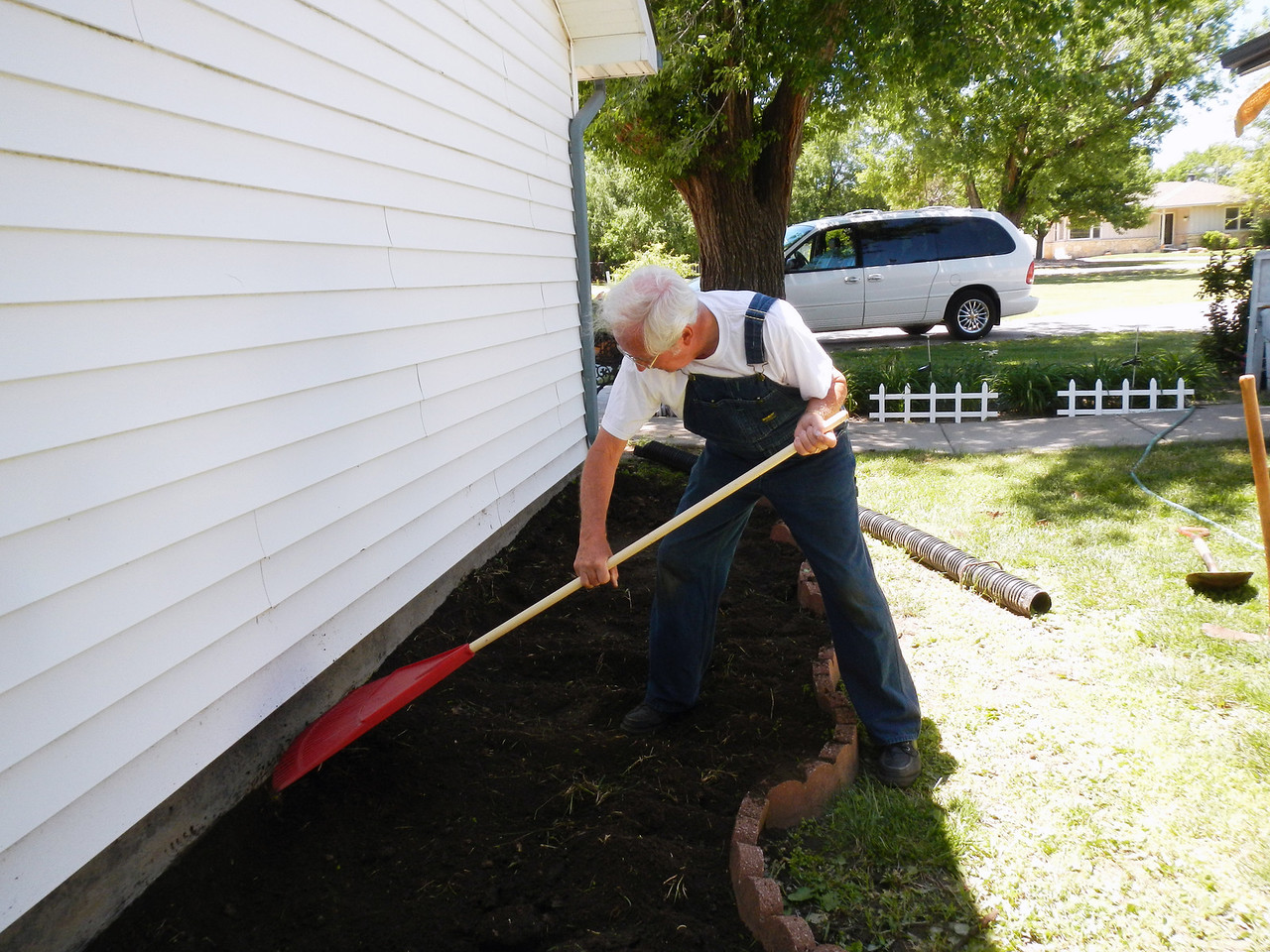 Farmer Gary is working the soil with his favorite rake.  (taken 6-2-13)