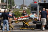 Accident victim is transported from the ambulance at the scene to the waiting NC Police helicopter. September 4th, shortly before 2 pm. Photo by Kathy Leistner