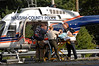 Male accident victim, from Nissan Maxxima, is transported from the ambulance at the scene to the waiting NC Police helicopter which landed on Sunrise Highway.  Sunrise Highway was closed, in both directions, for over two hours. September 4th, shortly before 2 pm. Photo by Kathy Leistner