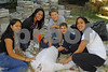 Community service for local HS tudents assisting at the Scarecrow building activity, a fund raiser for the Five Town Child Care Center. Volunteers and customers- L-R Melissa Aguilar, Inwood, Joelisa Diaz, Inwood, Simon, 12, and Isaac Greebal, 8, Woodmere, and Melissa Diaz, Inwood.  Rockhall Museum County Fair, October 21st, 2007. Photo by Kathy Lesitner
