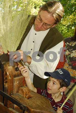 L-R Jonathan Duda, Ashokan Field Campus, Oliveridge, NY and Avraham Scheinberg, 4 of Cedarhurst make a colonial broom out of sorghum.   Rockhall Museum County Fair, October 21st, 2007. Photo by Kathy Lesitner