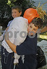 Community service for local HS tudents assisting at the Scarecrow building activity, a fund raiser for the Five Town Child Care Center.  Simon, 12, and Isaac Greebal, 8, Woodmere. Rockhall Museum County Fair, October 21st, 2007. Photo by Kathy Lesitner