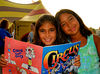 Sisters at the Circus. Cristina, 9 and Gianna, 8  Galan, enjoy their circus book during intermission, August 6th, 2007. Photo by Kathy Leisnter