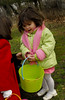 Isabella Scholl, 2, Lynbrook, with her found eggs.  March 7th, Hall's Pond Park Lion's Club Egg Hunt. Photo by Kathy Leistner.