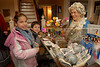 L-R Kathrine, 11 and her brother John, 7, Grandazza look at gifts for sale with Martha Washington (Ruthann Zarico). Pagan-Fletcher Restoration. February 18th, 2007. President's Day Celebration. Photo by Kathy Leistner