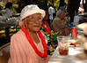 Senior, Minnie Harris of Inwood, sits in the shade with friends and a plate of barbeque.  5th Annual Family Unit Day, August 11th, 2007. Photo by Kathy Leistner