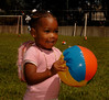 Makayala Scott,2, Inwood, enjoys the games for kids provided at the  5th Annual Family Unit Day, August 11th, 2007. Photo by Kathy Leistner
