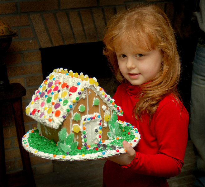 Brianna Kilmet of Valley Stream takes her house home after the contest. Gingerbread House Contest and Bake Sale, December 3rd, Pagan- Fletcher Restoration, Photo by Kathy Leistner