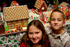 "L- R Samantha, 10 and William Presby, 7 with their creation ""The Cottage"" which took two days to build. Gingerbread House Contest and Bake Sale, December 3rd, Pagan- Fletcher Restoration, Photo by Kathy Leistnr"