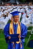 Valedictorian Philip Tan with his new diploma in hand waits for the VSCHS school photographer to record the moment. VSCHS graduation, June 22, 2007. Photo by Kathy Leistner