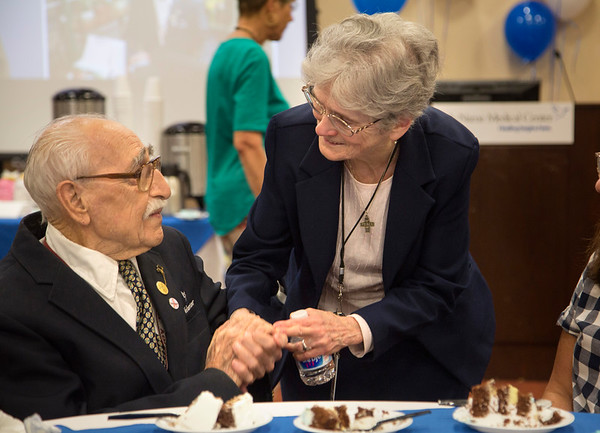 Holy Name Medical Center volunteer and veteran Herand Kafafian celebrated his 100th birthday at Holy Name Medical Center on September 5, 2018. <br /> <br /> Heron served the US Army as a photographer from 1942-1945 stationed in the Philippines. He was awarded the Purple Heart for injuries in the invasion of Leyte, under the command of General Douglas MacArthur.<br /> Pictured L to R is Herand Kafafian with Sister Breda Boyle, Director of Pastoral Care at Holy Name Medical Center.