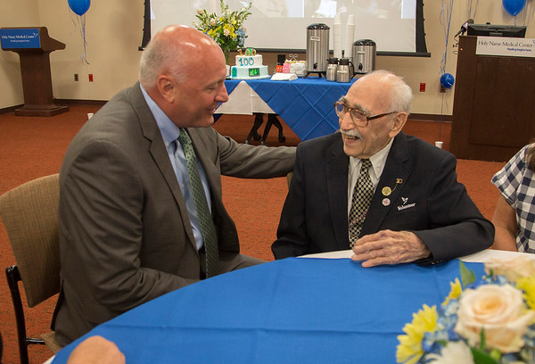 Holy Name Medical Center volunteer and veteran Herand Kafafian celebrated his 100th birthday at Holy Name Medical Center on September 5, 2018. <br /> <br /> Heron served the US Army as a photographer from 1942-1945 stationed in the Philippines. He was awarded the Purple Heart for injuries in the invasion of Leyte, under the command of General Douglas MacArthur.<br /> Pictured L to R is Michael Maron, President and CEO of Holy Name Medical Center with Herand Kafafian