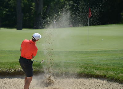 Tania Barricklo-Daily Freeman                      Justin Lane chips the ball out of the sand trap.