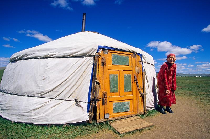 Old lady ouside her ger (yurt). Ihtamir. Mongolia.