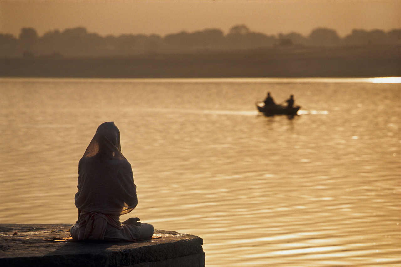 Meditation by the Ganges, Varanasi. India.