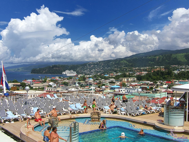 The weather had been fabulous on the cruise thus far and when we woke up and stepped outside after arriving at Dominica the weather seemed even more gorgeous, if that were possible. The blue skies, cottony clouds and richly colorful hillsides of the island begged to be photographed with a panoramic camera, or at least my 20mm wide angle using my old F3. No such luck as all my old equipment was in veritable mothballs, so however wide this camera went was going to have to do, and it wasn't doing enough...... My growing itch to burn a large chunk of my upcoming tax refund on a new digital Nikon was getting so big I was going to need a whole bottle of calamine lotion to hide the rash.