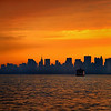 I've lived on Staten Island for over 20 years now and as I used to ride into Manhattan each day, the smoggy haze that at times used to hang over the New York skyline, would ruin a lot of potentially good shots. But thankfully such days are now long gone. On this particular morning as I stood at the front of the ferry on my ride to the city, there was a foggy haze blanketing the city scape, a quality of atmosphere that enhances as opposed to the old smog that detracted from a scene. That combined with the warm sunrise (and no small  amount of editing on my computer) combined to turn this view of Manhatten into a kind of pastel like art work. (For those of you not familiar with the NYC skyline, the building just a tad left of dead center with the pointy top is the Empire State building).