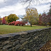 All through the afternoon Ricia and I came across these wonderful looking stone walls, fencing off peoples property. Seeing them brought back memories of when I went to school in New England as a teenager. And I remember coming across one like that once, and found it interesting as well back then. But I can't remember if it was perfectly even on all sides like all of these were, which is it's signature feature.<br /> <br /> How they could get a fence to be so flat on top and the sides when all the stones are of such a variety of different sizes and shapes is a marvel. I snapped shots of several that we saw today. But as we drove down this particular street this wall took the cake. It was more than twice the length of what you see here in this photo, and Reesh could tell that I really was enamored with this one which was the grandest example of all the ones we'd seen. So she parked around the corner and let me get out to photograph it.<br /> <br /> When I got to a suitably photogenic spot I snapped the shutter on my camera, then walked back to Reesh's SUV, which was some walk as long as this wall was. What a fantastic looking way to fence off your property, very New England like.