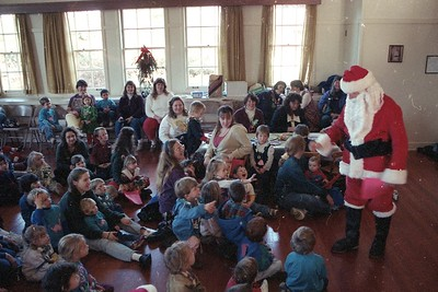 Santa Claus (Jose Quezada) entertains children at the Dec. 8, 1994 Christmas party for the Humboldt Child Care Council. Kids also enjoyed a puppet show, holiday crafts and music by The Kitchenaires. (Times-Standard file photo)
