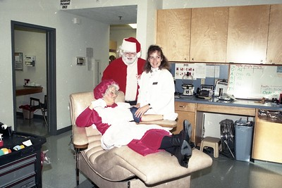 Santa and Mrs. Claus (Dr. Joe Antony and his wife, Cheryl) donate blood in December 1996 at the Northern California Community Blood Bank. Helping them is registered nurse Amy Larum, right. (Times-Standard file photo)