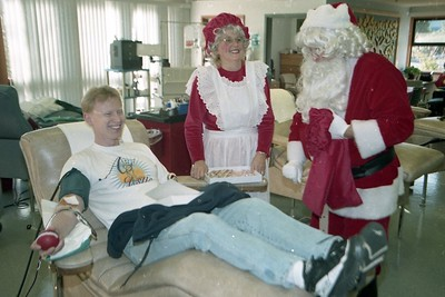 Blood plasma donor Gary Lee Chapman is visited by Santa and Mrs. Claus (Dr. Joe and Cheryl Antony) at the Northern California Community Blood Bank on Dec. 18, 1998. That same day, Santa helped Graystone Jewelers owner Jody Rusconi donate $1,000 to the blood bank. (Times-Standard file photo)