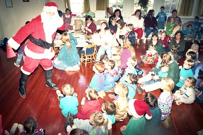 Santa Claus (aka Jose Quezada) sings Christmas carols with kids at the Dec. 8, 1994 Humboldt Child Care Council Christmas party. (Times-Standard file photo)