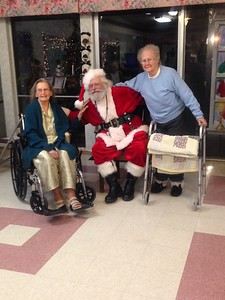 Santa Claus (John Egerer of Eureka) visits with residents Martha and Betty at the Granada Rehabilitation and Wellness Center in Eureka  Dec. 8, 2017. Egerer has been portraying the Jolly Old Elf locally for more than three decades. (John Egerer — Contributed)