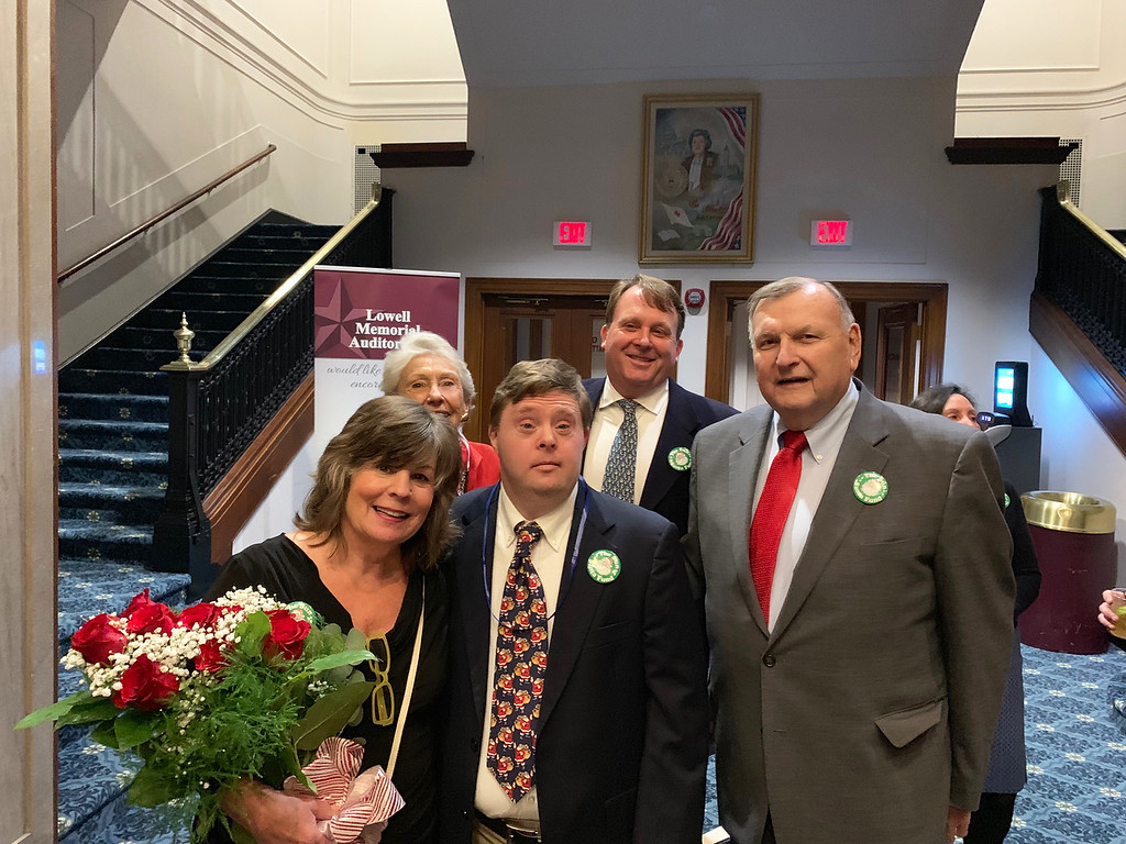. From left, Sun Santa Coordinator Nancy Roberts receives beautiful roses from Nancy, Philip and Danny Donahue, and Terry McCarthy, all of Lowell.