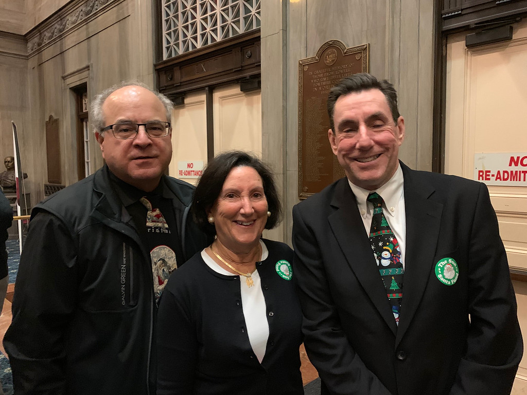 . From left, �The Wine Novice� columnist and former Sun Editor Jim Campanini and The Hon. Barbra Pearson, both of Lowell, and Sun Publisher Kevin Corrado of Billerica