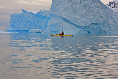Kayaking Near an Iceberg