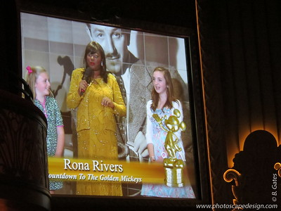 The Golden Mickeys - The Pre-Show  As you walk down the red carpet and into the Walt Disney Theatre for The Golden Mickeys awards ceremony, don't be surprised if your little one becomes the star of the show, compliments of Disney Cruise Line celebrity interviewer Rona Rivers. With microphone in hand, Rona interviews boys and girls about such topics as fashion, friends and family—broadcast in real time via video camera onto screens within the Walt Disney Theatre for all to see.