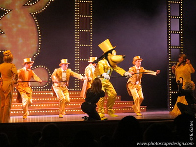 The Golden Mickeys  The Golden Mickeys is an approximate 50-minute, musical live show celebrating the star in us.    A tribute to the musical heritage of Walt Disney, The Golden Mickeys is an awards show in which Disney movie Characters are nominated in several categories, including heroism and romance.  The Golden Mickeys features songs and Disney Characters from the following Disney films:  Snow White and the Seven Dwarfs, Sleeping Beauty, Mulan, Toy Story, Pocahantas, One Hundred and One Dalmatians, Lady and the Tramp, The Lion King, and the The Hunchback of Notre Dame.  Additionally, The Golden Mickeys includes special appearances by Mickey Mouse, Minnie Mouse and Goofy.