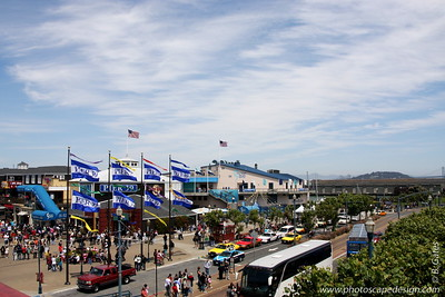 Pier 39  Pier 39 is a shopping center and popular tourist attraction built on a pier in San Francisco, California. At Pier 39, there are shops, restaurants, a video arcade, street performances, an interpretive center for the Marine Mammal Center, the Aquarium of the Bay, virtual 3D rides, and views of California sea lions hauled out on docks on Pier 39's marina. The marina is also home to the floating Forbes Island restaurant. A two-story carousel is one of the pier's more dominant features, although it is not directly visible from the street and sits towards the end of the pier. The family-oriented entertainment and presence of marine mammals make this a popular tourist location for families with children.  From the pier one can see Angel Island, Alcatraz, the Golden Gate Bridge, and the Bay Bridge.   Pier 39 was first developed by entrepreneur Warren Simmons and opened October 4, 1978.