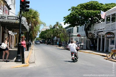 Key West (June 4, 2008)  Corner of Greene Street and Duval Street - Home to Sloppy Joe's.  Scooters and Key West go hand in hand.