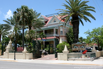 Key West (June 4, 2008)  Located on the ocean,  The Southernmost House Grand Hotel & Museum was built in 1896 for a cost of $250,000 (approximately $6 million today) by Judge J. Vining Harris, who married into the prominent Curry family. In 1939, the Ramos family purchased the property, which had been converted into a Cuban nightclub called Café Cayo Hueso (Bone Island Café), for $49,000.  In 1954, it was converted back into a residence and remained so until 1996 when a $3 million restoration began to turn it into a 13-room hotel, with a museum on the first floor.  Exterior paint colors are authentic, as are elegant crown moldings, ceiling medallions, ornamental woodwork and friezes, which were originally painted white, but have been redone in splashy shades reminiscent of its days as a Cuban nightclub.