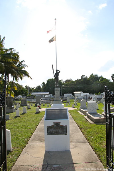U.S.S. Maine Monument  On February 15, 1898, the USS Maine blew up in Havana Harbor, killing some 260 American sailors, a disaster that led to the U.S. declaring war on Spain. Some two dozen of those dead are buried in the plot, on either side fot he central copper statue. Other Spanish-American War veterans lay nearby. Civil War era markers line the perimeter of the fence. Veterans of other wars may also be found in the plot, along with two British airmen, on Brazilian sailor, one woman, and one baby. The iron fence and gates with spear points and battle-axes were manufactured by a foundry in Washington, D.C.