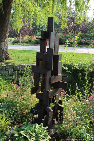 Plates & Shadows - Amber Conger, Artist - This sculpture was created in 2008 and is made of steel.  It was donated to the Garden by the artist and is located in the Herb Garden.
