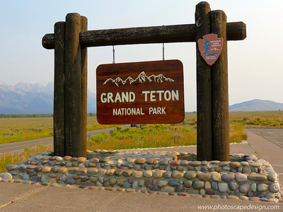 Grand Teton National Park consists of approximately 310,000 acres (130,000 ha).  The park includes the major peaks of the 40-mile-long (64 km) Teton Range as well as most of the northern sections of the valley known as Jackson Hole. It is only 10 miles (16 km) south of Yellowstone National Park, to which it is connected by the National Park Service-managed John D. Rockefeller, Jr. Memorial Parkway. Along with surrounding National Forests, these three protected areas constitute the almost 18,000,000-acre (7,300,000 ha) Greater Yellowstone Ecosystem, one of the largest intact mid-latitude temperate ecosystems in the world. Human history of the Grand Teton region dates back at least 11,000 years, when the first nomadic hunter-gatherer Paleo-Indians began migrating into the region during warmer months pursuing food and supplies.