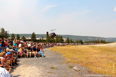 Hundreds of people sit around waiting for the incredible display of Old Faithful.