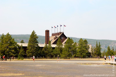"As a national historic landmark, Old Faithful Inn is the most requested lodging facility in the park. Built in 1903-1904 with local logs and stone, the Inn is considered the largest log structure in the world. The towering lobby features a massive stone fireplace and a hand-crafted clock made of copper, wood and wrought iron serving as focal points. With its spectacular log and limb lobby and massive (500-ton, 85-foot) stone fireplace, the inn is a prime example of the ""Golden Age"" of rustic resort architecture, a style which is also known as National Park Service Rustic. It was the first of the great park lodges of the American west."