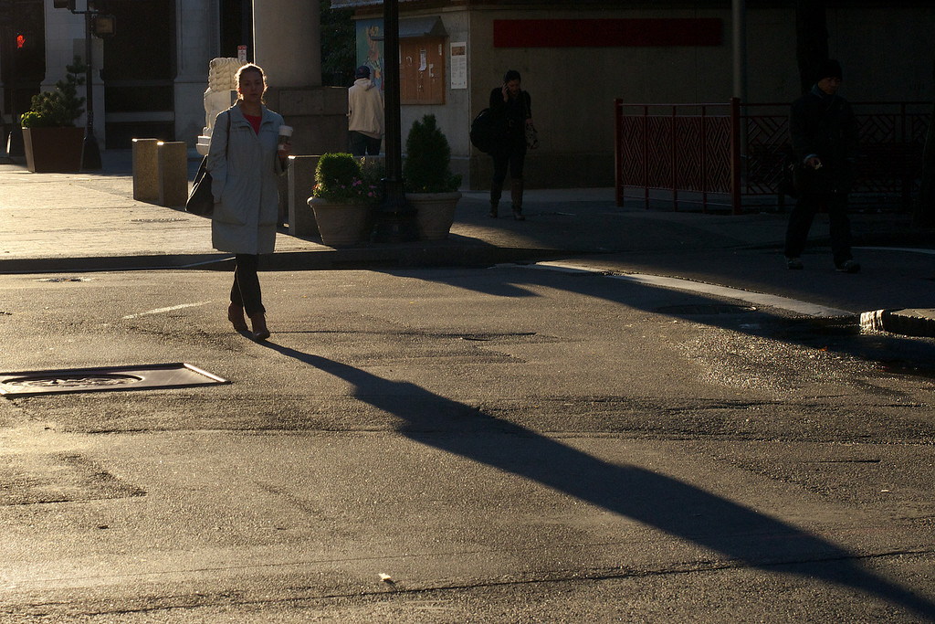 Boston, October 11, 2012: <br /> A long shadow is cast by the sunrise on Beach Street in Chinatown.  Photo by Peter Smith