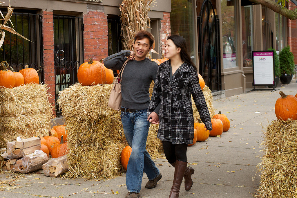 Fall colors are ablaze as a couple stroll hand in hand down Tremont Street through Boston's South End.<br /> <br /> October 9, 2012; Photo by Peter Smith