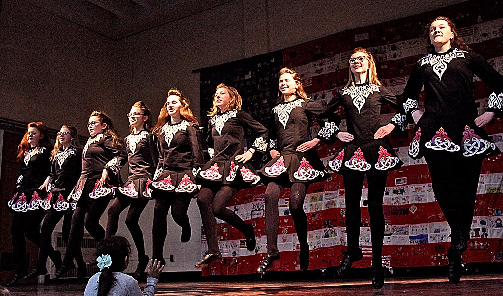 . Looking like a scene from Riverdance are the Irish dancers from Heavey-Quinn Academy of Irish Dance of Chelmsford at the Heritage Festival at Harrington School. SUN/ David H. Brow