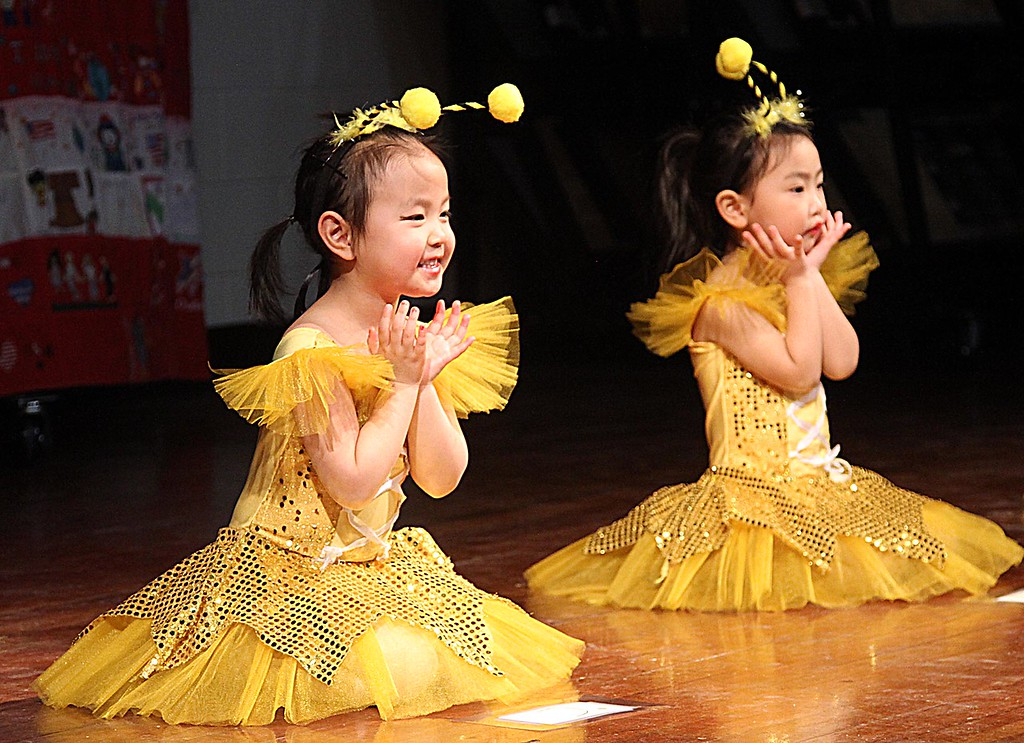 . Little dancers from the Chelmford Chinese Language School, L-R, Evelyn Shen, 4, and Rachel Ye, 3, as they perform at the 6th Annual Harrington School Heritage Festival. SUN/ David H. Brow