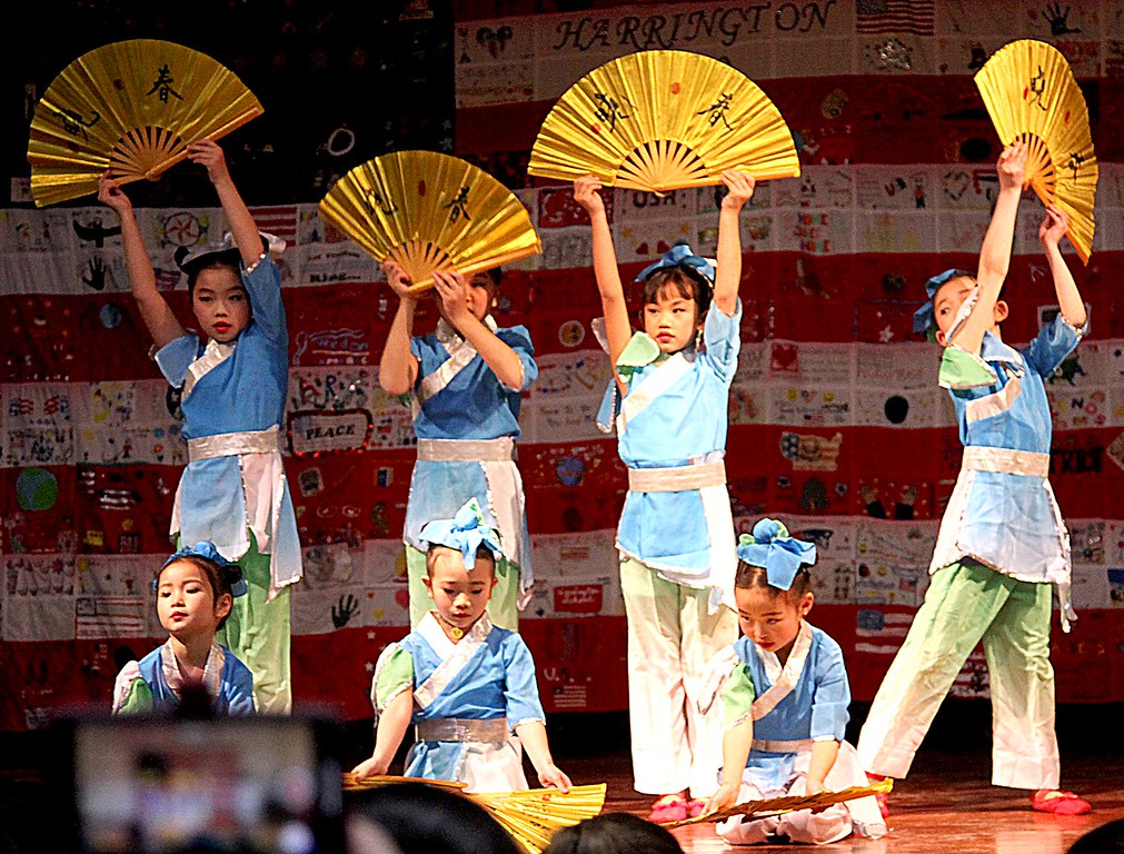 . 5-, 6- and 7-year-old dancers from the Chelmsford Chinese Language School dance with fans at the 6th Annual Heritage Festival at Harrington Elementary School. SUN/ David H. Brow