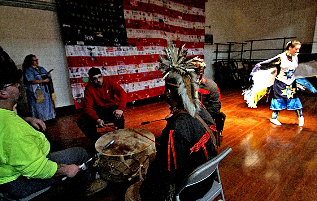 . Members of the Greater Lowell Indian Cultural Association beat on a drum as Macayla Spirit Dancer Libby dances the Turtle Dance on right at Harrington School\'s 6th Annual Heritage Festival. SUN/ David H. Brow